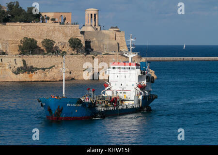 The bunkering vessel Salina Bay entering harbor in Malta. Offshore bunkering (refuelling of ships) is an important - Stock Image