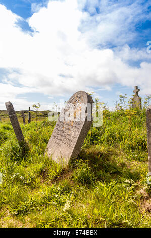 leaning old gravestones in an abandoned coastal cemetery - Stock Image