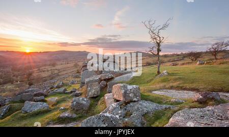 Sunset from Cuckoo Rock Dartmoor National Park Devon Uk - Stock Image