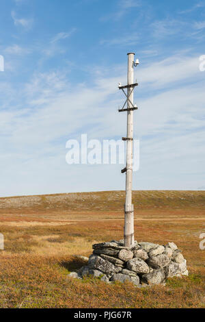 Old telegraph post at the mountain plateau 'Finnmarksvidda' in Alta, Finnmark, Norway. - Stock Image