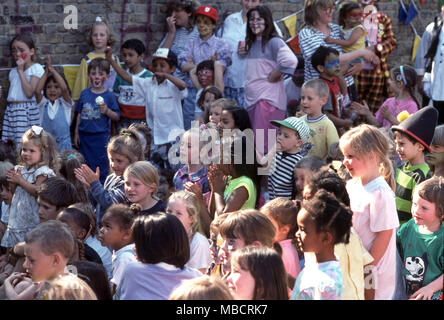 A group of children watching a clown show - Stock Image