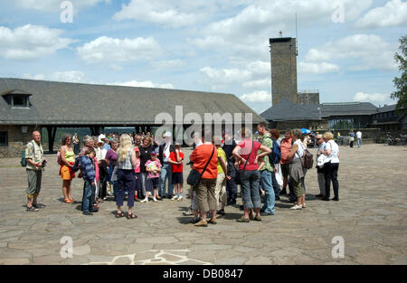Visitors are pictured at the Adler square of the Ordensburg Vogelsang castle at national park Eiffel, Gemuend, Germany, - Stock Image
