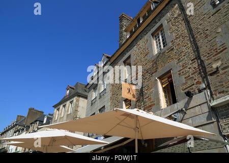 Buildings and shops in Grande Rue des Stuarts, Dol de Bretagne, Ille et Vilaine, Brittany, France - Stock Image