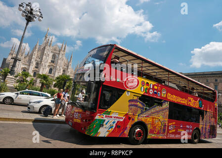 Horizontal streetview of a tour bus in Milan, Italy. - Stock Image