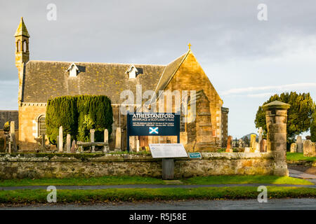 Athelstaneford village Parish Church, National Flag Heritage Centre saltire birthplace churchyard and gravestones, Scotland, UK - Stock Image