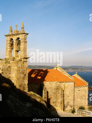 Spain. Galicia. Province of La Coruña. Muxia. Parish Church of Santa Maria of Muxia. It was built in the 14 century in Gothic sailor style over an earlier temple of the 12th century. - Stock Image