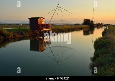 fishing houses at sunset in cervia, rimini. italy - Stock Image