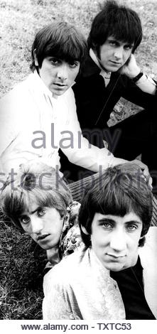 Black and white group portrait of the band The Who, Pete Townshend, Roger Daltrey, Keith Moon, John Entwistle seated together outdoors. Credit: 385940_Globe Photos/MediaPunch - Stock Image