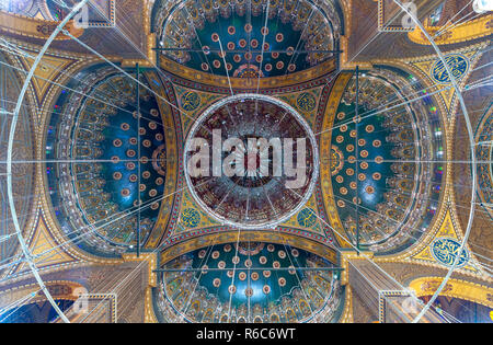 Ceiling of the great Mosque of Muhammad Ali Pasha (Alabaster Mosque) decorated with golden and blue floral patterns, situated in the Citadel of Cairo  - Stock Image