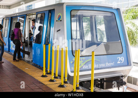 Miami Florida Omni Loop Metromover guard pole public transportation mass transit automated people-mover passenger Black woman bo - Stock Image