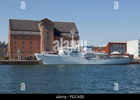 British yacht Capella C moored at Toldbodgade at sculpture David and art gallery Royal Cast Collection in the old West Indian warehouse in Copenhagen - Stock Image