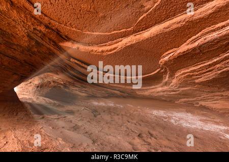 Small cliff cave on Hunts Mesa, Monument Valley Tribal Park, Arizona - Stock Image