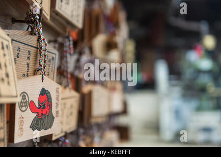 Ema, wooden wishing plaques hanging outside a buddhist temple - Stock Image