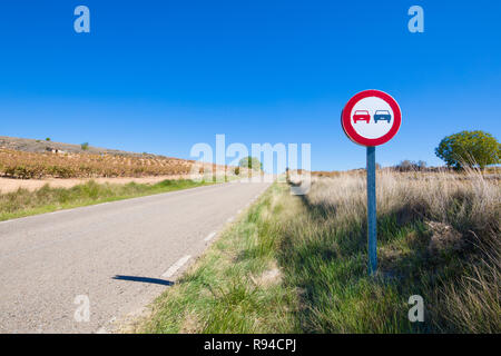 no overtaking signal in rural road in a landscape in Castile, Spain, Europe - Stock Image