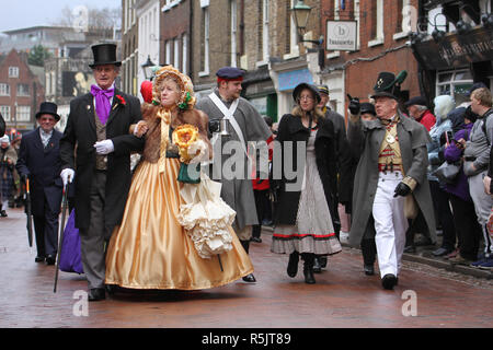 Rochester, Kent, UK. 1st December 2018: People dressed in Victorian costume from the Dickensian Age particiapte in the main parade on Rochester High Street. Hundreds of people attended the Dickensian Festival in Rochester on 1 December 2018. The festival's main parade has participants in Victorian period costume from the Dickensian age. The town and area was the setting of many of Charles Dickens novels and is the setting to two annual festivals in his honor. Photos: David Mbiyu/ Alamy Live News - Stock Image