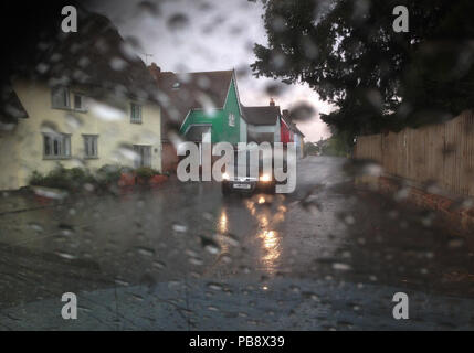 Thaxted, North West Essex. 27th July 2018. UK Weather: Heavy rain falling in Thaxted North West Essex, England UK. 27 July 2018 Rain storm falling in Thaxted Essex UK viewed from driver in stationary car Credit: BRIAN HARRIS/Alamy Live News - Stock Image