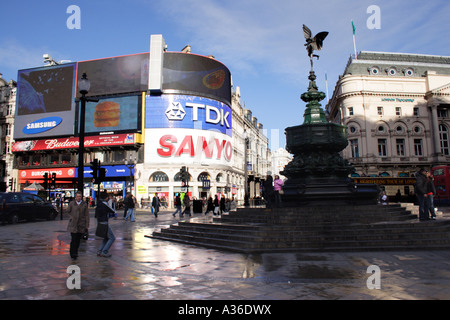 Piccadilly Circus and Statue of Eros on a wet winters day London - Stock Image