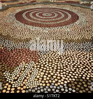 Australian Aboriginal Art on the forecourt of Australia's Parliament House in Canberra - Stock Image