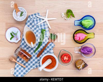 Alternative skin care various scrubs, lemon grass scrubs ,lavender scrubs, tomato scrubs ,turmeric powder in white - Stock Image