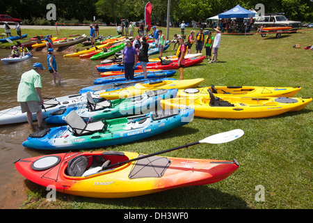 People attending a public kayaking event on a lake in Bella Vista, Arkansas, USA. - Stock Image