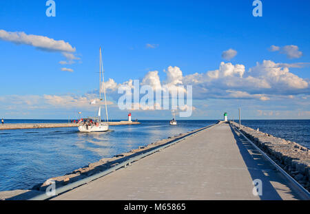 Sailboats leaving Frenchman's Bay and enteing Lake Ontario, in Pickering, Ontario, Canada - Stock Image