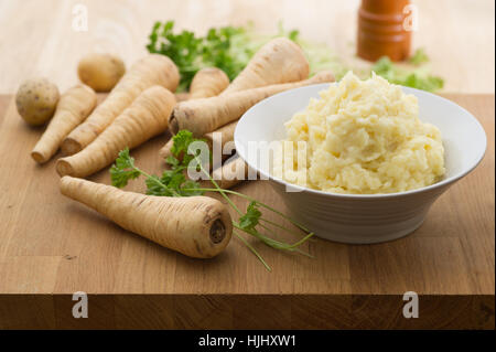 Homemade parsnip and potato mash with parsley. - Stock Image