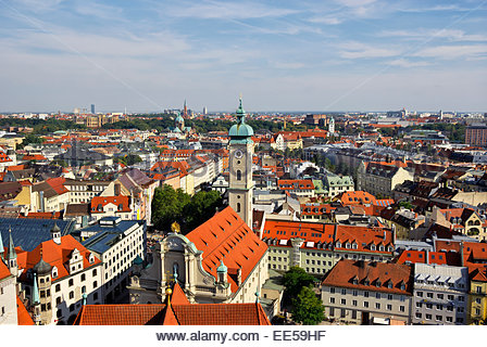Eastward view of Munich from tower of Peterskirche shows Heilig-Geiste-Kirche and other historic architecture. - Stock Image