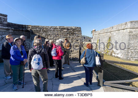 A tour group in the ravelin, or outwork fortification, at the Castillo de San Marcos, a Spanish fortification at St. Augustine, Florida USA - Stock Image