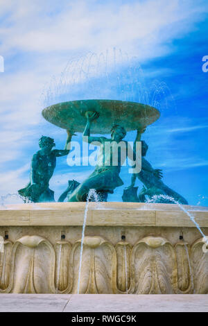 The imposing Triton Fountain, designed by Vincent Apap, situated just outside the historical City Gate of the Malta's capital - Floriana, Malta. - Stock Image