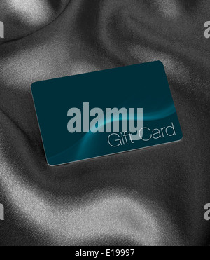 Store Gift Card now used instead of gift vouchers against a silk background with blank area for inserting your own brand or logo - Stock Image