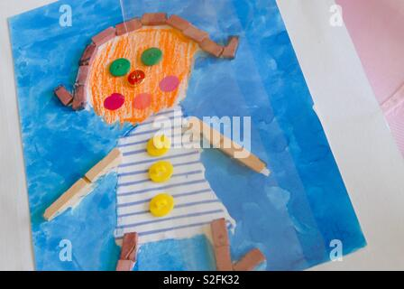 Kids drawing with blue - Stock Image