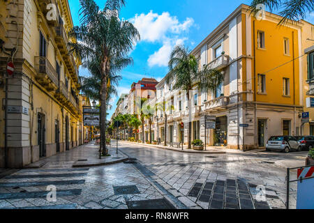 Empty streets and closed shops and cafes on a summer morning on the main street, Corso Umberto, through the town center of Brindisi Italy - Stock Image