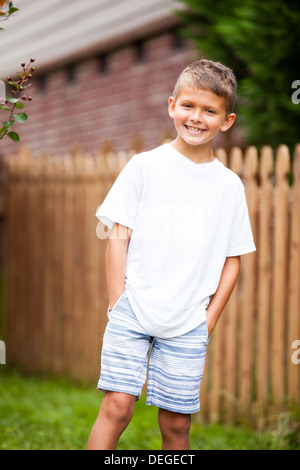 portrait of boy with hands in pockets - Stock Image