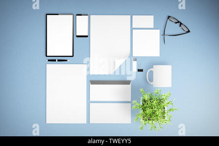 top view of devices and branding elements on light blue desktop mockup 3d rendering - Stock Image