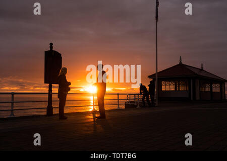 Aberystwyth Wales UK, Monday 17 June 2019  UK Weather:After day of showery rain and grey overcast skies, a fiery sunset fills the sky over Cardigan Bay at Aberystwyth on the west wales coast.  photo credit: Keith Morris//Alamy Live News - Stock Image