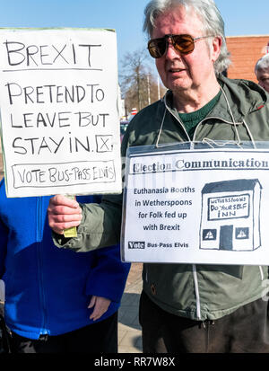 David Bishop leader of the Vote bus pass elvis demonstrates with home made banners outside a Labour party rally. - Stock Image