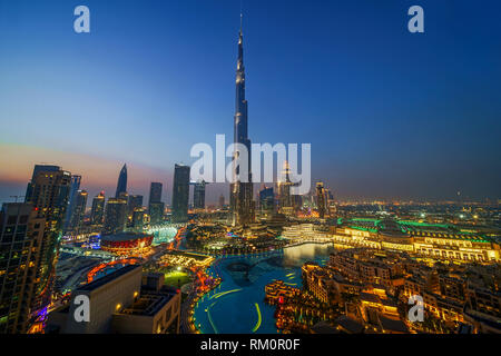 The Burj Khalifa soars 829 meters into the clear Arabian sky and towers over the luxuriant oasis of Dubai. - Stock Image