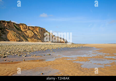 A view of coastal features with cliffs of glacial sands on the North Norfolk coast at East Runton, Norfolk, England, United Kingdom, Europe. - Stock Image