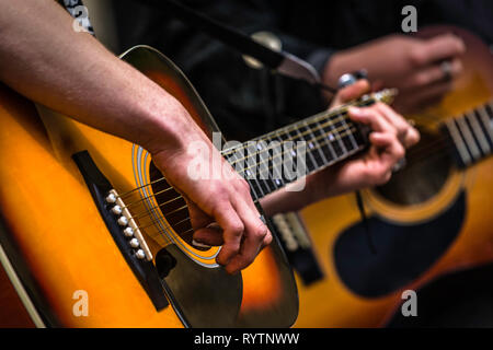 Guitarists at a busing festival in Lincoln. - Stock Image