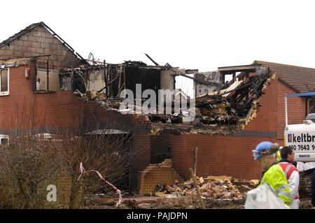 Keltbray digger and damaged house that had to be demolished at the scene of accident of Cessna 501 Citation VR-BGE that fatally crashed into the house - Stock Image