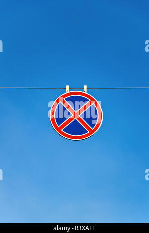 road sign stop and parking is prohibited against the blue sky - Stock Image