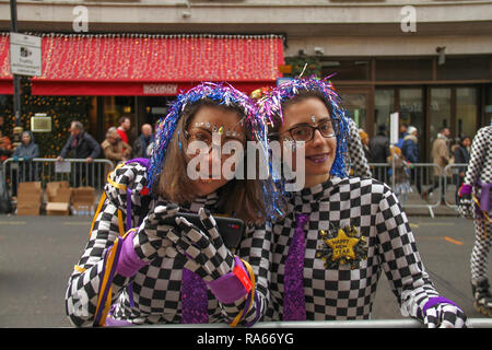 London, UK. 1st January, 2019. Skaters pose for photos at Berkeley Square ahead of the parade. About 8,000 performers representing the London boroughs and over 20 countries from across the globe take part on the annual New Years Parade on the street of London on January 1, 2019. The parade will as is custom include dancers, acrobats, cheerleaders, marching bands, historic vehicles and huge balloons making their way from Green Park Tube station to Parliament Square. Credit: david mbiyu/Alamy Live News - Stock Image