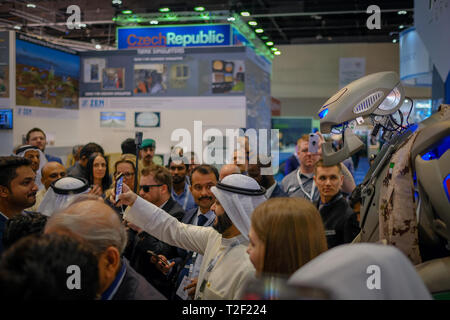 February 18, 2019 - Abu Dhabi, UAE: People taking selfies with TITAN - The Greeting Robot - Stock Image