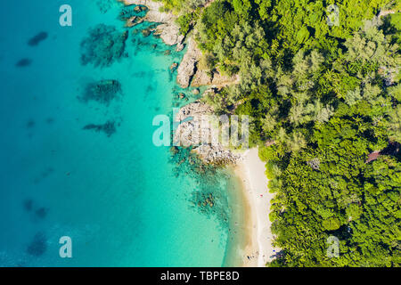 View from above, stunning aerial view of a tropical coast with a white beach bathed by a turquoise clear sea. Phuket, Thailand. - Stock Image