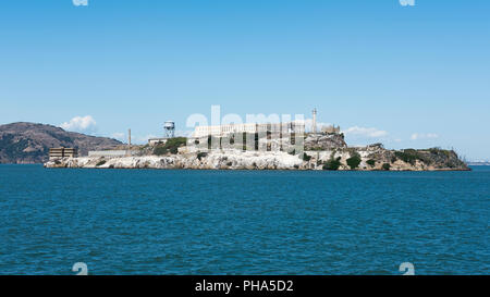 Alcatraz Island, view from San Francisco Bay, facing east, long side, of the famous abandoned federal prison, now a museum opened to tours and public - Stock Image