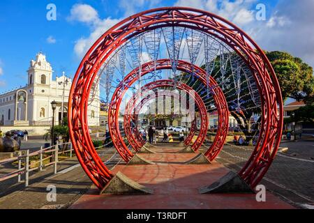 Concentric Red Circles Abstract Art Detail and Spanish Colonial Architecture on Plaza De Las Artes (Arts Town Square) San Jose Costa Rica City Center - Stock Image