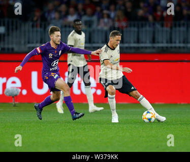 Optus Stadium, Perth, Western Australia. 13th July, 2019Optus Stadium, Perth, Western Australia. 13th July, 2019. Pre-season friendly football, Perth Glory versus Manchester United; Nemanja Matic of Manchester United shields the ball from Chris Harold of the Perth Glory Credit: Action Plus Sports/Alamy Live News Credit: Action Plus Sports Images/Alamy Live News - Stock Image