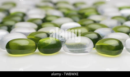 artificial round stones of green and white color. imitation pebbles - Stock Image