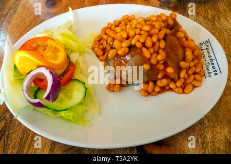 Cheap wholesome lunch jacket potato baked beans and salad at the Stonehouse bakery Danby - Stock Image