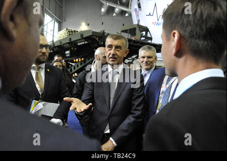 Brno, Czech Republic. 29th May, 2019. Czech PM Andrej Babis (centre) visits the international trade fair of defence and security technology IDET, trade fair of security technology and services ISET and trade fair of firefighting technology PYROS in Brno, Czech Republic, May 29, 2019. On the photo right there is defeated Czech presidential candidate Jiri Hynek. Credit: Igor Zehl/CTK Photo/Alamy Live News - Stock Image